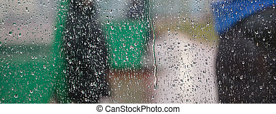 Raindrops on transparent window. Abstract, blurred background, close up view, banner, space for text.