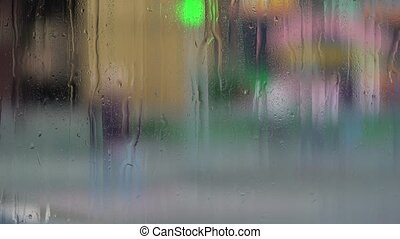 Raindrops on window glass. Blurry background - Raindrops on...