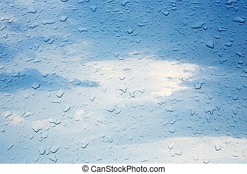 Raindrops on Window - rain drops on glass against the cloudy...