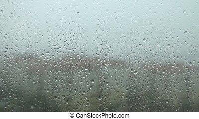 Raindrops - Rain drops running  window pane