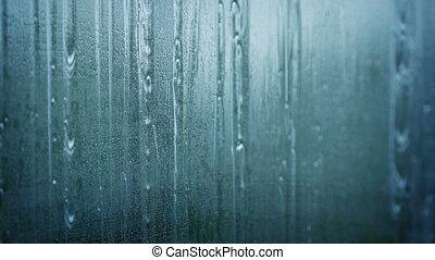 Raindrops Running Down Glass Window - Heavy rain on glass...