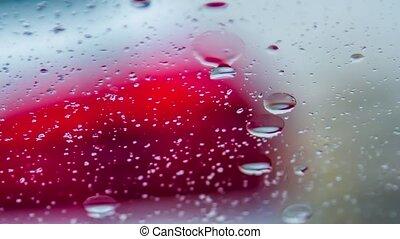 Raindrops Running On Car Window During Rain
