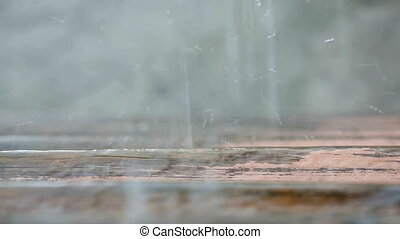 Raindrops Splashing On the Wooden Stairs