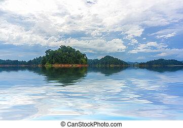 Rainforest island - Reflection of rain forest at Kenyir...