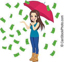 Raining Money Bills - Beautiful brunette woman holding big...