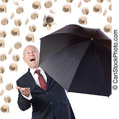 Raining Money - Man in suit with umbrella concept of getting...