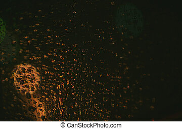 raining night blur bokeh on road vintage color tone