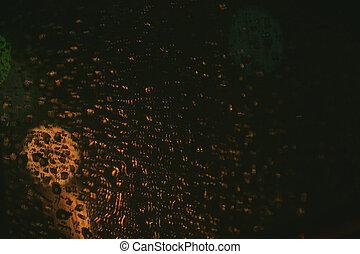 raining night blur bokeh on road vintage color tone