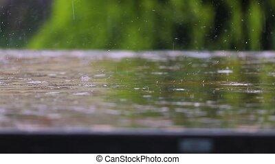 Raining on a park table