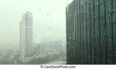 raining outside of high building