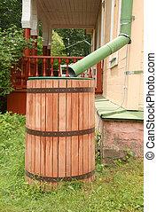 Rainwater Collection Barrel - Old rainwater barrel near...