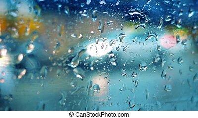 Rainy City Road Through Window