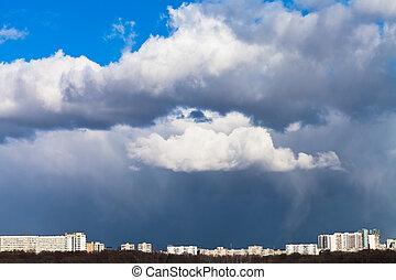 rainy clouds over city