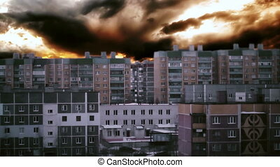 rainy clouds sweep over multi-residential buildings.