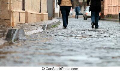 rainy cobbled street