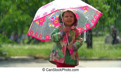 Rainy Day - Cute baby bouncing with umbrella in rainfall