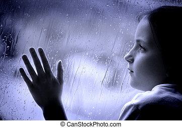 Rainy Day  - Girl looking out window on a rainy day