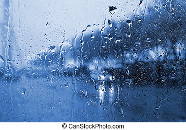 rainy day - car in town in rainy day