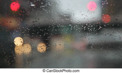 Rainy day. Traffic passes. - View through windshield looking...
