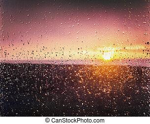 rainy dramatic sunset in window