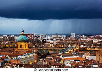 Rainy evening in Toulouse, France, view on La Grave hospital and Saint Pierre bridge, Saint Syprien district