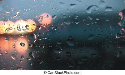 Rainy highway drive. Wet window.