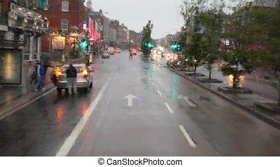Rainy Lower Mount Street through window of moving bus in Dublin, Ireland.