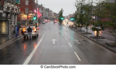 Rainy Lower Mount Street through window of moving bus in Dublin, Ireland.