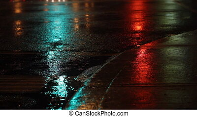 Rainy night. Traffic lights green,
