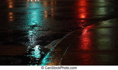 Rainy night. Traffic lights green,