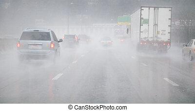 Rainy Road - Vehicles on wet road in the rain