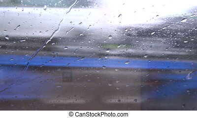Rainy wet bus car window and speed background