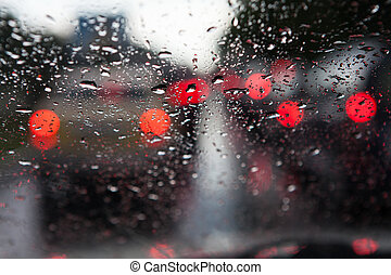 rainy window in blocked traffic