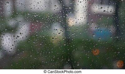 Rainy window surface - Raindrops on a window with urban...