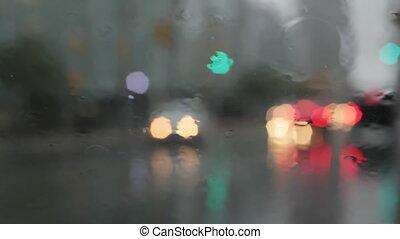 Rainy window with traffic.