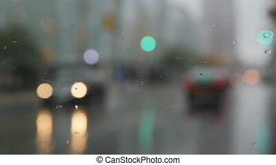 Rainy wipers. - View of intersection through rainy...