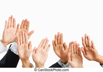 People raise hand to be picked up or to bid in an auction