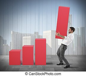 Raise profits - Businessman raises a big step of statistic