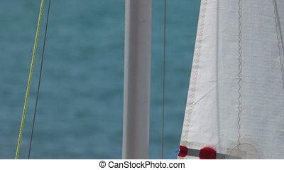 raise sail - raise the sail on a yacht