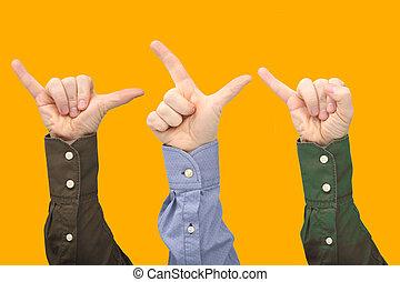 Raised hands of different men on orange background