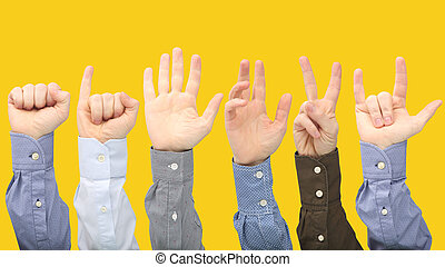 Raised hands of different men on yellow background