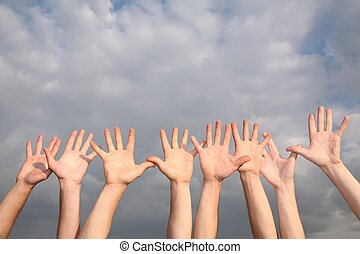 raised hands on cloudy sky background  2