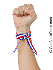 Raised Up Clenched Fist With Tricolor Stripes Wrist Band.