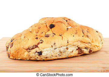 raisin bread on wooden cutting board