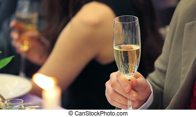 Raising glasses of champagne to a toast