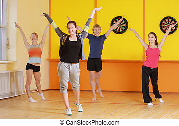 Raising hands in group aerobics