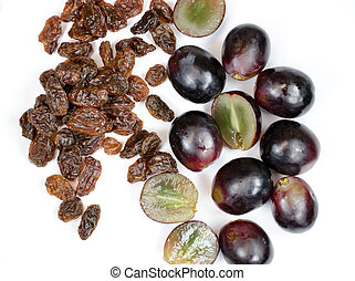 Raisins and grapes on white background