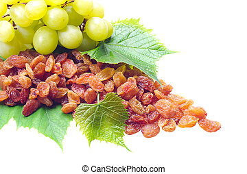 Raisins and grapes with leaves