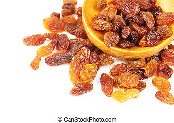 raisins and wooden spoon close- up isolated on white background