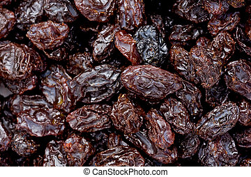 Raisins - Background texture of several raisins.